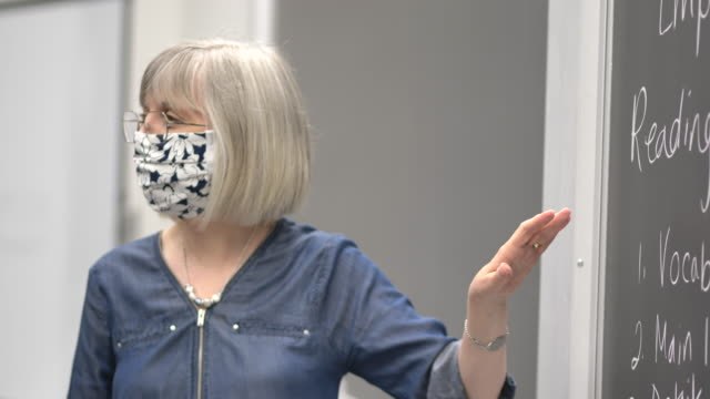 university professor wearing a mask while teaching - back to school stock videos & royalty-free footage