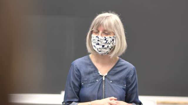 university professor wearing a mask while teaching - lockdown stock videos & royalty-free footage