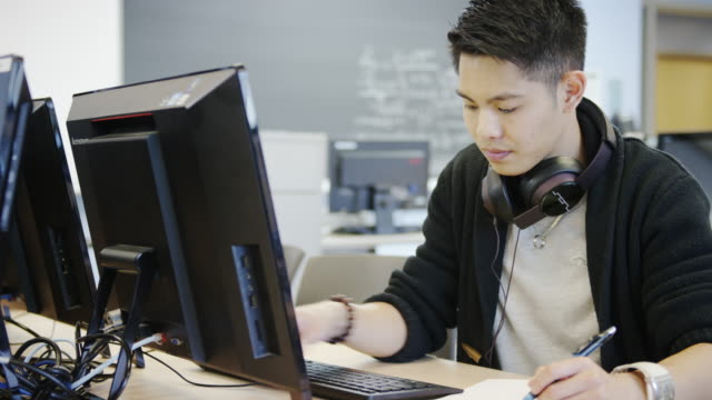 University student in a computer lab