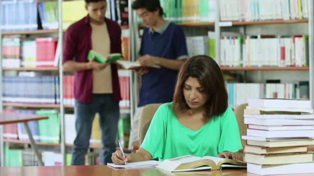 University student studying in the library, Noida, Uttar Pradesh, India