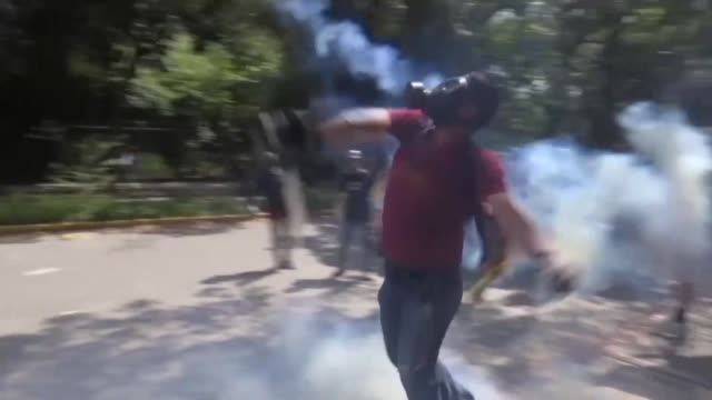 university students and national police clash after an opposition rally at the central university of venezuela - crisis stock videos & royalty-free footage