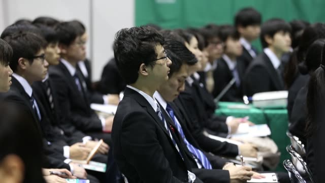 University students attend talks at a job fair hosted by Mynavi Corp in Tokyo Japan on Sunday March 20 2016