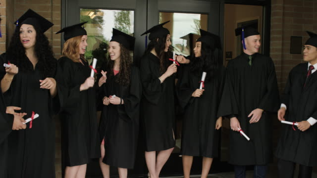 university students excited and taking selfies after graduation - diploma stock videos and b-roll footage