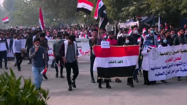 university students march in iraq's shrine city of karbala shout slogans and hold signs rejecting the current pm candidates of the government as they... - karbala stock videos & royalty-free footage