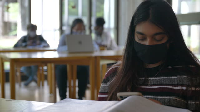 university students studying on campus wearing masks - fatcamera stock videos & royalty-free footage