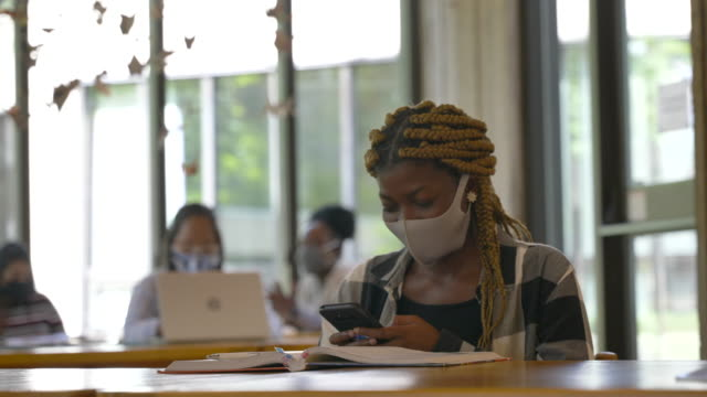 university students studying on campus wearing masks - back to school stock videos & royalty-free footage