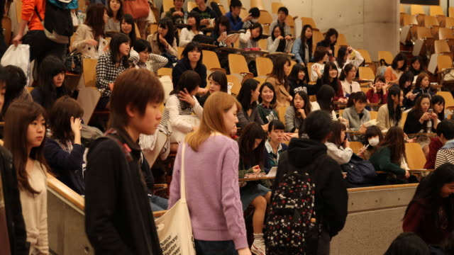 university students taking a sit in a big lecture hall - auditorium stock videos & royalty-free footage