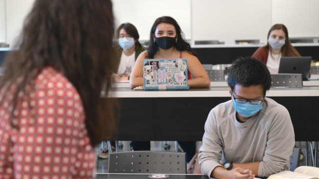 university students wearing masks in class - lecture hall stock videos & royalty-free footage