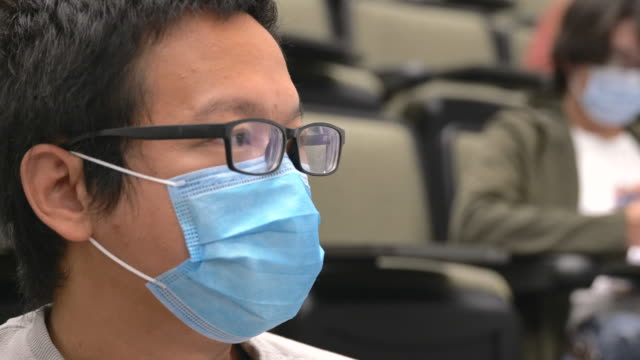 university students wearing masks in class - back to school stock videos & royalty-free footage