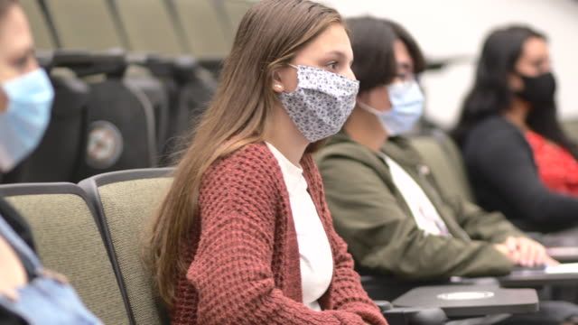 university students wearing masks in class - university student stock videos & royalty-free footage