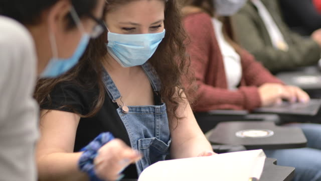 university students wearing masks in class - fatcamera stock videos & royalty-free footage