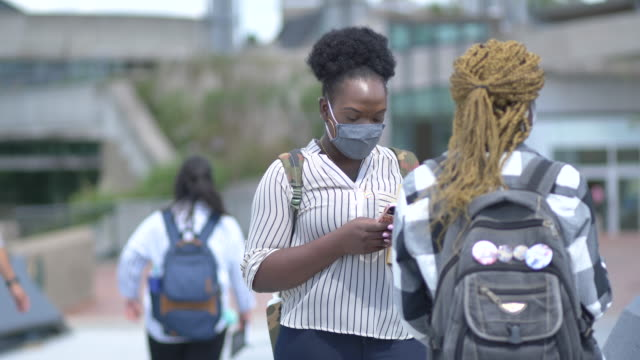 university students wearing masks on campus - post secondary education stock videos & royalty-free footage