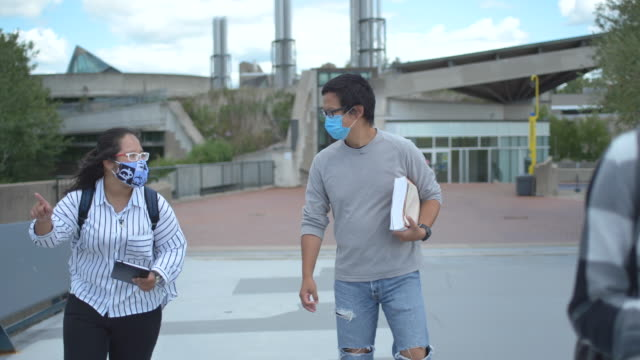 university students wearing masks on campus - campus stock videos & royalty-free footage