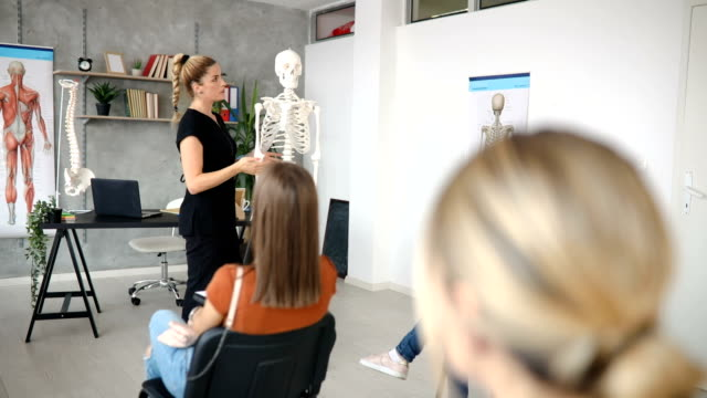 university teacher leading an anatomy class and explaining to students everything about human skeleton - anatomy stock videos & royalty-free footage