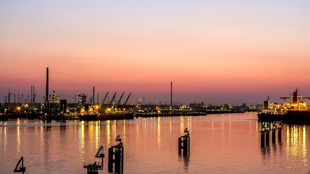 unloading bulk ships at dusk - customs stock videos & royalty-free footage