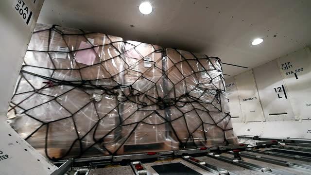 unloading cargo inside cargo aircraft - cargo aeroplane stock videos & royalty-free footage