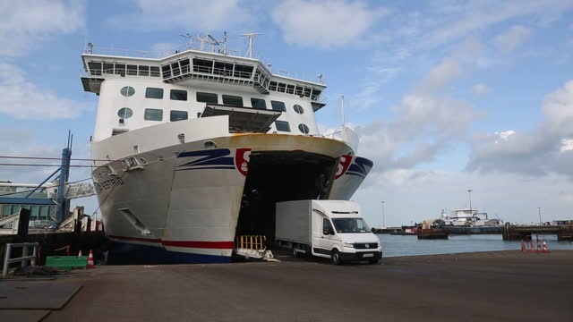 unloading cargo ships at port of cherbourg, linking france with uk. the cost of shipping goods from france to britain has surged in the past year... - western script stock videos & royalty-free footage