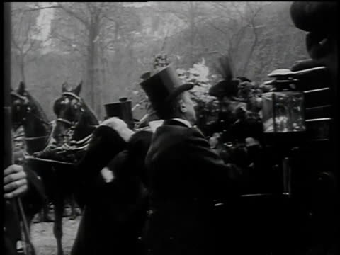 Unloading flowers and dignitaries from horsedrawn carriage / Paris France