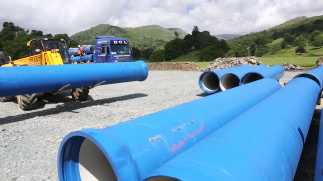 unloading hydro pipes for the new rydal hall hydro electric scheme, ambleside, lake district, uk. - unloading stock videos & royalty-free footage