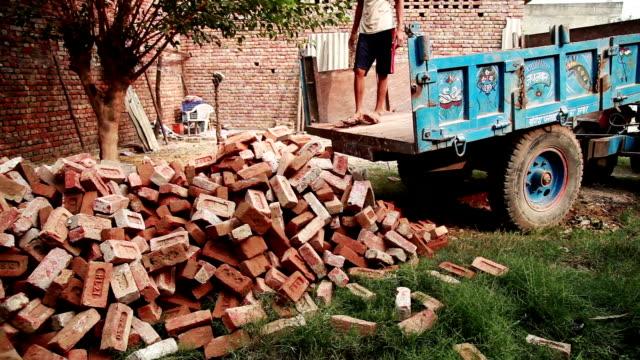 unloading trolley full of bricks - brick stock videos & royalty-free footage