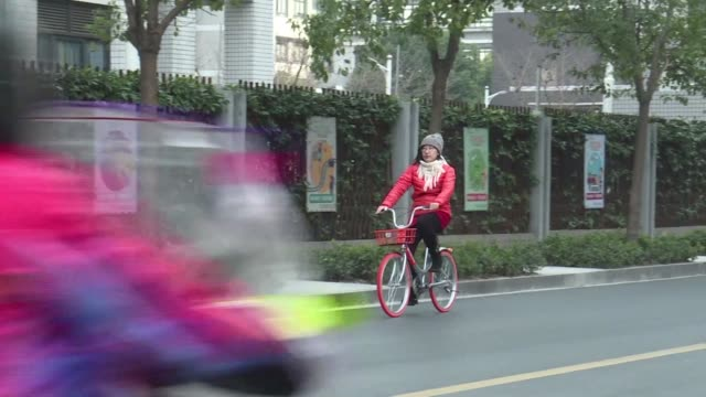 unlock them with an app drop them off anywhere and nip past lanes of stationary car traffic: the humble bicycle is seeing a revival in china as a new... - revival stock videos & royalty-free footage