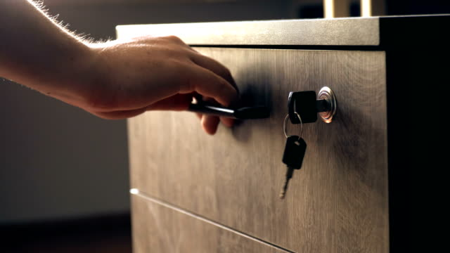 unlocking and opening drawer in office - drawer stock videos & royalty-free footage