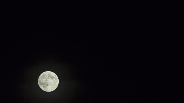 Unmanipulated time lapse of the full moon as it transits frame from lower-left to upper-right