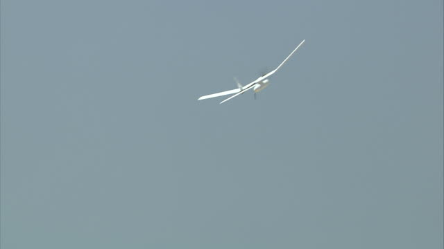 a unmanned aerial vehicle  is launched and soars across the sky. - 無人航空機点の映像素材/bロール