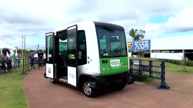 unmanned selfdriving buses began ferrying passengers on aug 1 japan at toyosuna park in chiba's mihama ward next to an aeon mall co shopping mall... - driverless transport stock videos & royalty-free footage