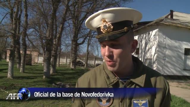 unos 200 manifestantes prorrusos asaltaron este sabado una base aerea del ejercito ucraniano en novofedorivka donde izaron la bandera de la marina... - 2014 stock videos and b-roll footage