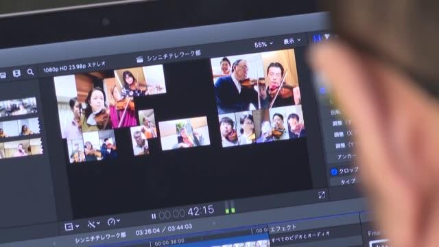 unos sesenta músicos de la nueva orquesta filarmónica de tokio afinan sus instrumentos antes de una inédito y salvador concierto una versión musical... - música stock videos & royalty-free footage