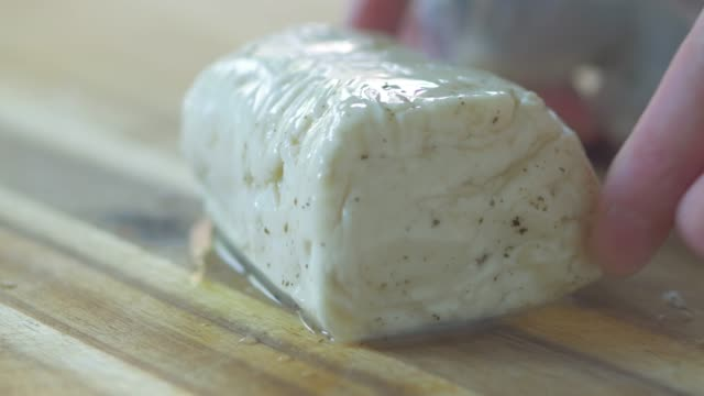 unpacking halloumi cheese - plank variation stock videos & royalty-free footage