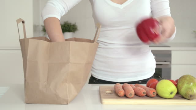 unpacking vegetables - paper bag stock videos & royalty-free footage