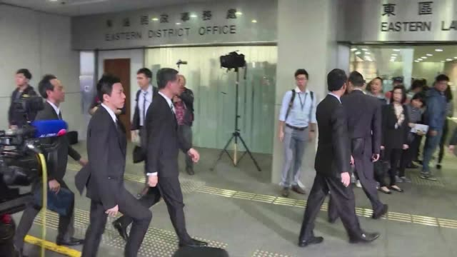 Unpopular Hong Kong leader Leung Chunying arrives to take the stand in an assault case against a legislator who threw a glass at him in parliament