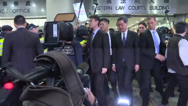 Unpopular Hong Kong leader Leung Chunying leaves court after taking the stand in an assault case against a legislator who threw a glass at him in...