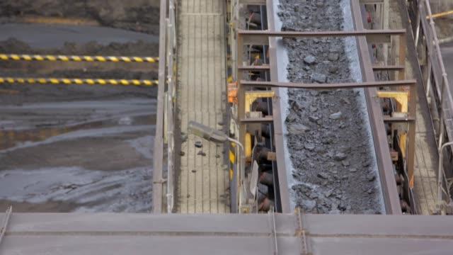 unprocessed coal moving on conveyor belt - coal mine stock videos & royalty-free footage