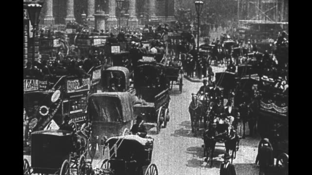 unreadable title card / historical footage of horsedrawn carriages driving past and around street corner in london / title card the bank had its... - 19th century stock videos & royalty-free footage