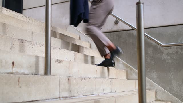 unrecognisable businessman running up stairs in the city - formal businesswear stock videos & royalty-free footage