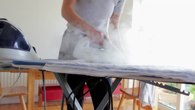 unrecognisable person ironing - iron appliance stock videos & royalty-free footage