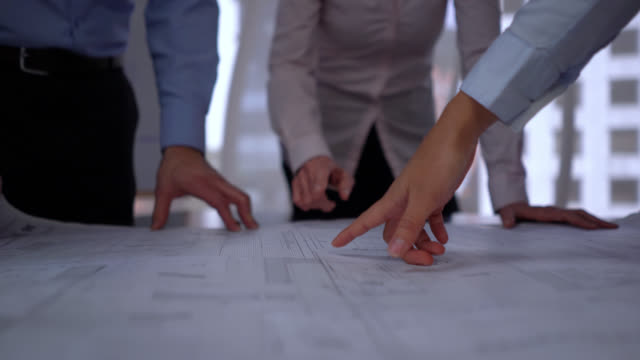 unrecognizable architects looking at a blueprint of a project - blueprint stock videos & royalty-free footage