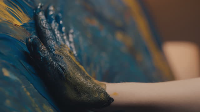 slo mo unrecognizable artist draws with a hand on the canvas - paint stock videos & royalty-free footage