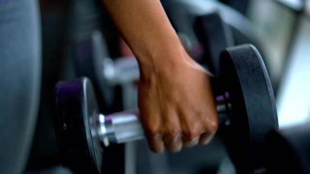 unrecognizable black person taking free weights at the gym - weight training stock videos and b-roll footage