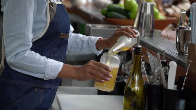 Unrecognizable black waitress serving a beer