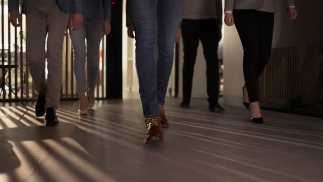 unrecognizable business people walking through a hallway. - shoe stock videos & royalty-free footage