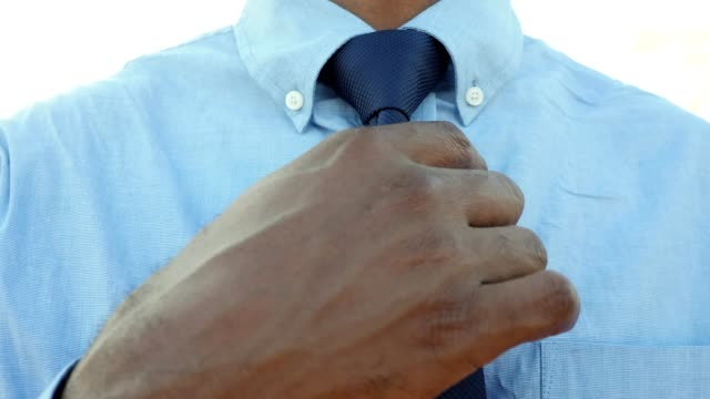 unrecognizable businessman adjusting necktie - necktie stock videos & royalty-free footage