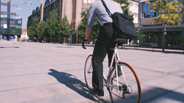 slo mo unrecognizable businessman riding his bicycle - commuter stock videos & royalty-free footage