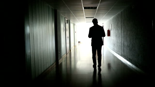 unrecognizable businessman working while walking in a dark hallway - suit stock videos & royalty-free footage