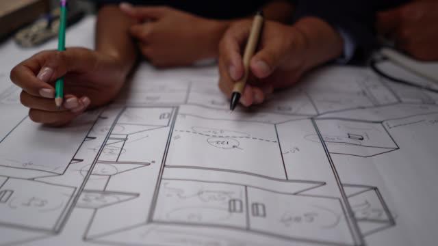 vídeos y material grabado en eventos de stock de un equipo diverso irreconocible de carpinteros que trabajan en un plano en un taller - cianotipo plano
