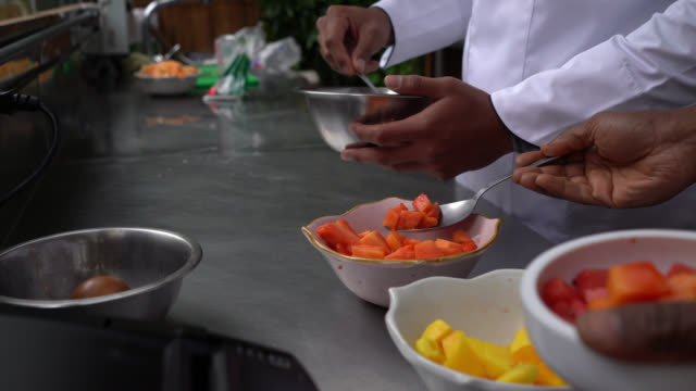 unrecognizable diverse team of cooks preparing different dishes at a restaurant - gourmet stock videos & royalty-free footage