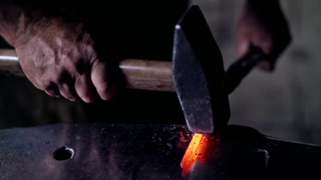 unrecognizable hands of blacksmith. - blacksmith stock videos & royalty-free footage